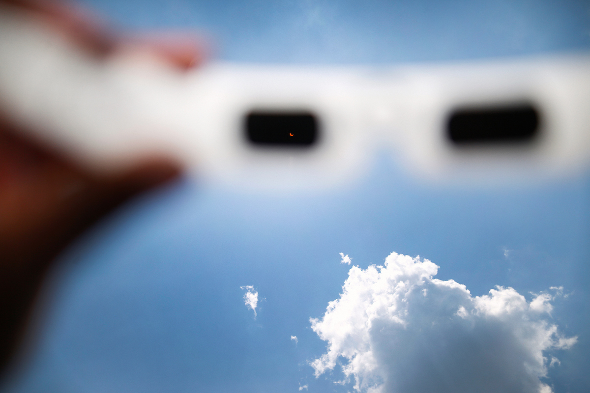 A pair of special solar eyeglasses captures Monday's brief phenomenon in which the moon spectacularly blocked the sun during the first eclipse in the U.S. since 1979. (Photo by Charles A. Smith/JSU)