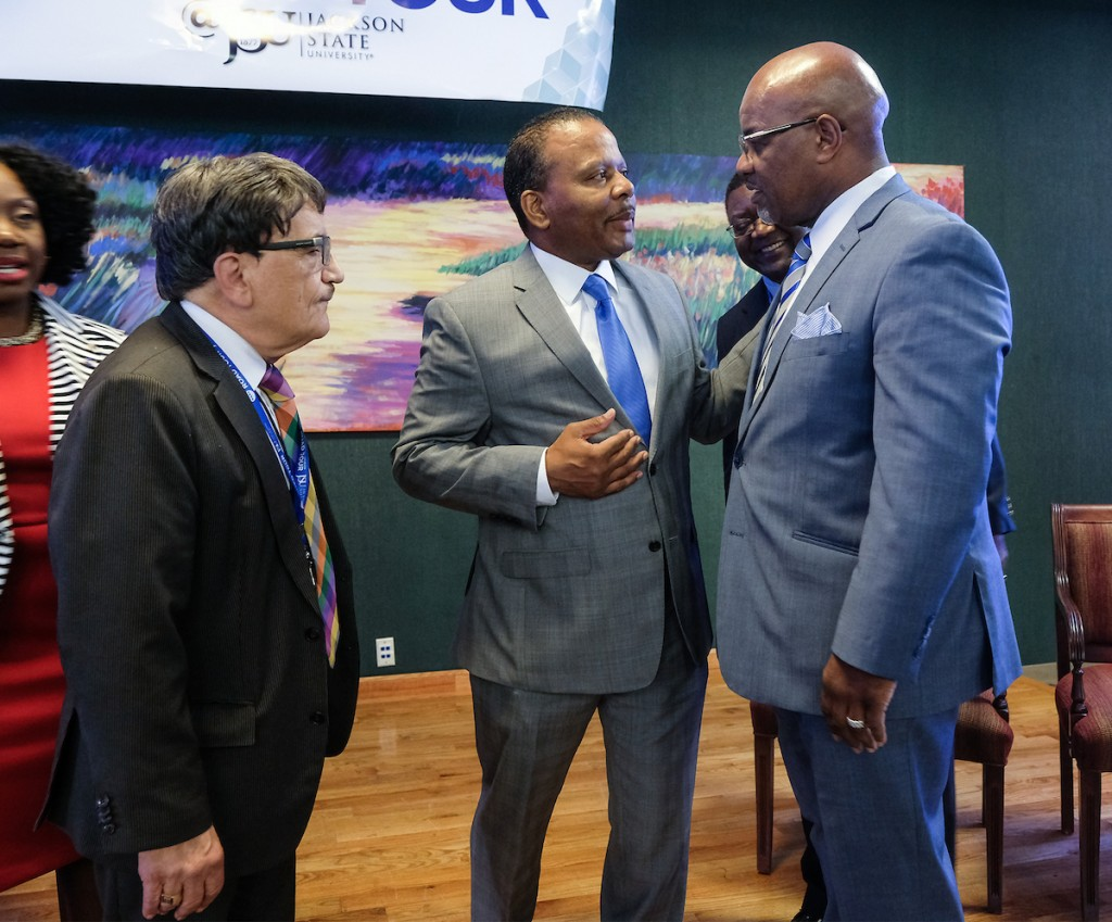 Bynum greets JSU alum and keynote speaker Jackson along with Dr. Richard A. Aló, dean of JSU's College of Science, Engineering and Technology. (Photo by Charles A. Smith/JSU)