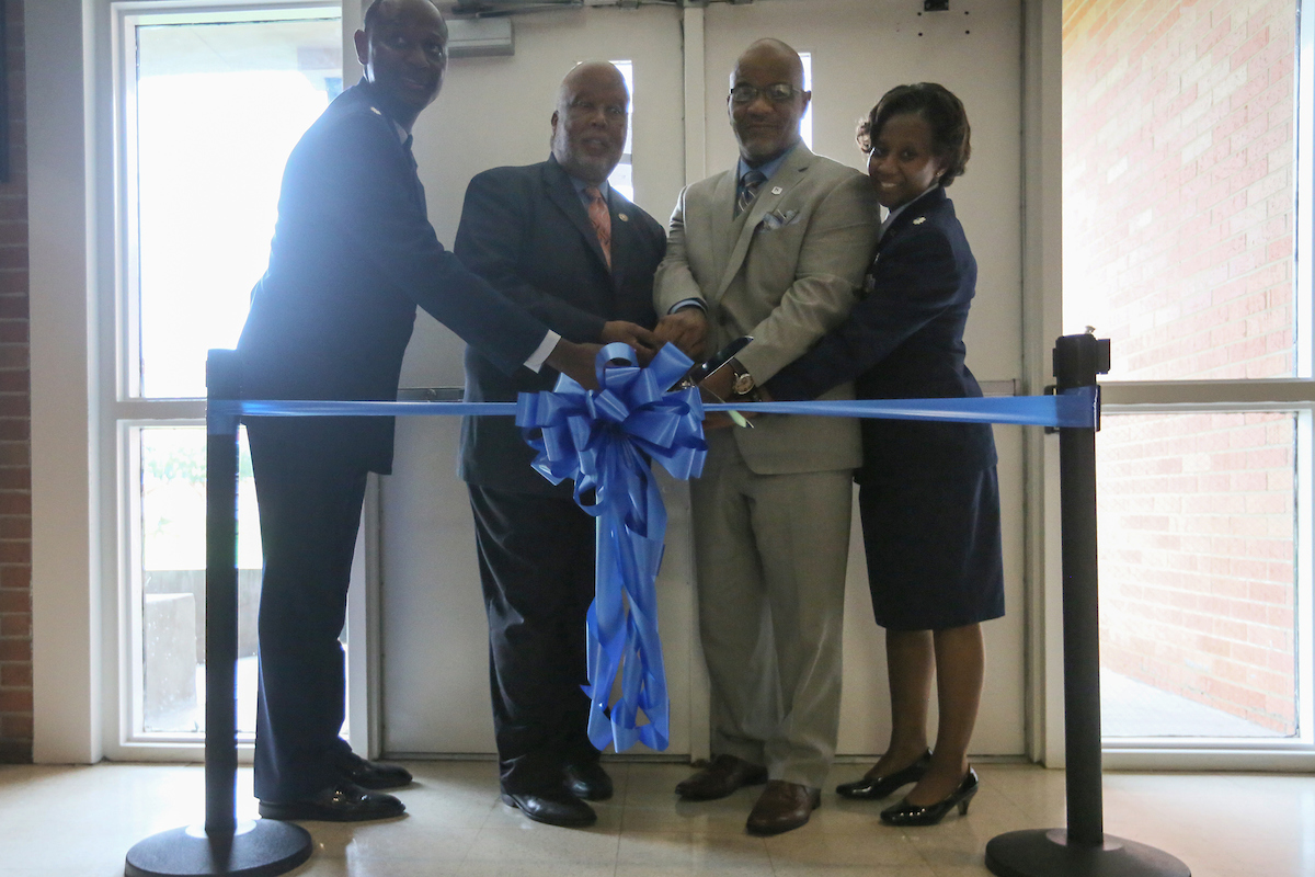 The new home of JSU's Air Force ROTC, located inside the J.Y. Woodard building, is official dedicated during a ribbon cutting. Joining JSU President William B. Bynum Jr. are Henderson, left, Thompson and Adams. (Photo by Aron Smith/JSU)