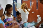 Dr. Edelia Carthan helps campers design and put together tutus during Camp Fabulous at Tougaloo College. Carthan was a teen mom, but regrouped and earned a doctorate from JSU before founding a Christian camp for young girls. (Photo by Justin Sellers/The Clarion Ledger)