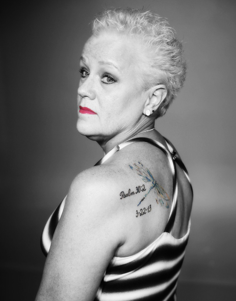 "This image of Yana Knight hangs in the museum. It displays her dragonfly tattoo as a symbol for embracing change and seeing it as ""positive and freeing."" (Photo by Spencer L. McClenty)"