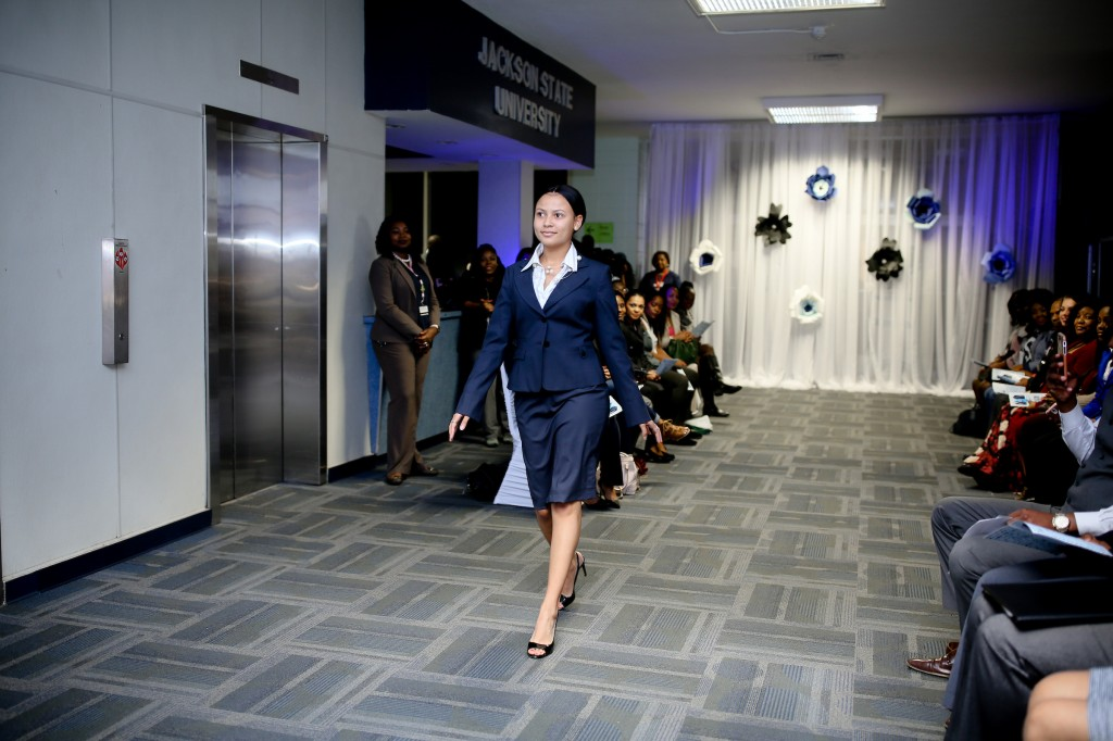 Wearing a suit donated by first lady Deborah Bynum, a student model struts down the make-shift runway inside of Jacob L. Reddixx during the fashion preview of the Tiger Career Closet. (Photo by Anissa Hidouk/JSU)
