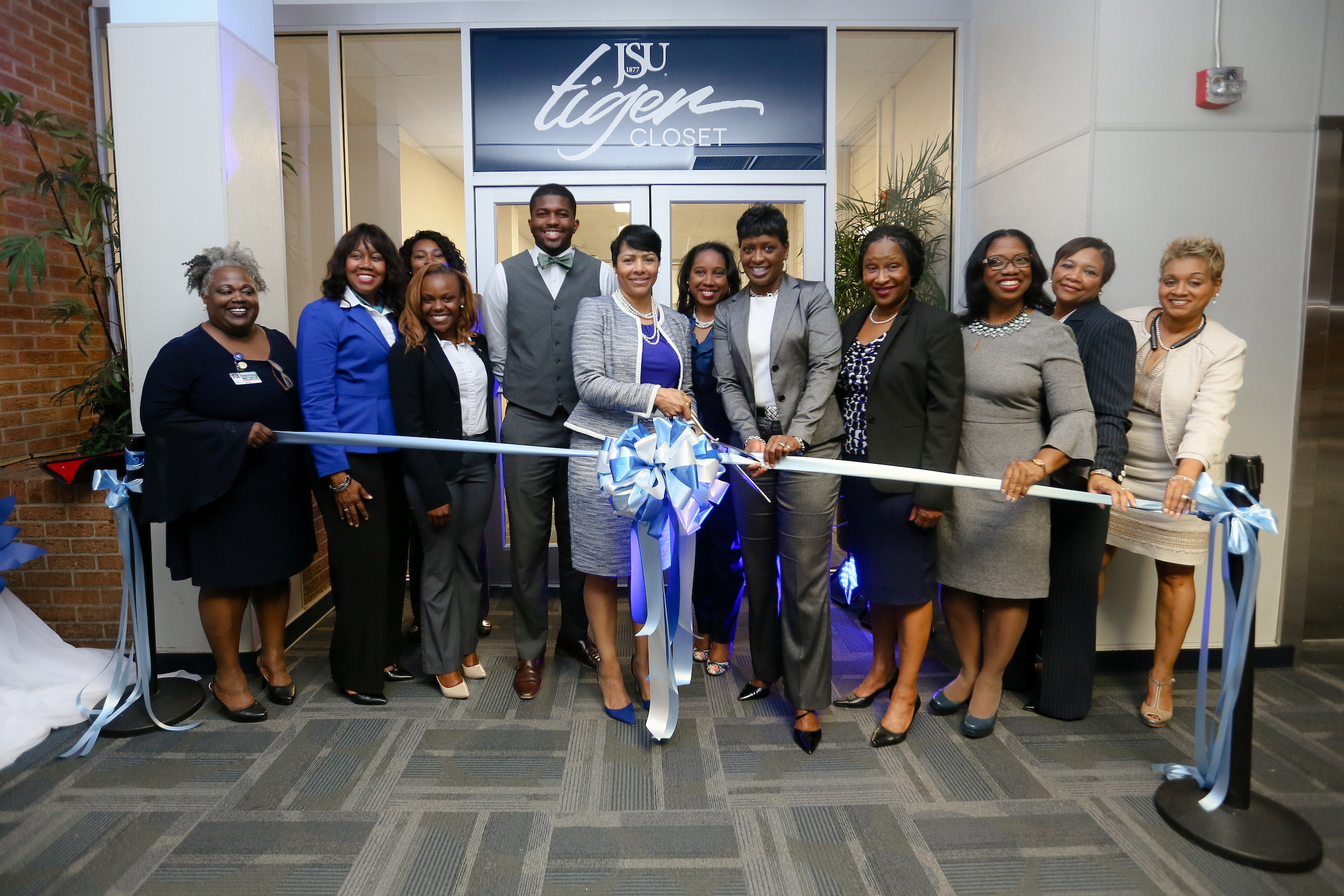 First lady Deborah Elaine Bynum prepares to cut the ribbon signaling the grand opening of the JSU Tiger Career Closet as she is flanked by those who helped bring her University initiative to fruition. (Photo by Anissa Hidouk/JSU)