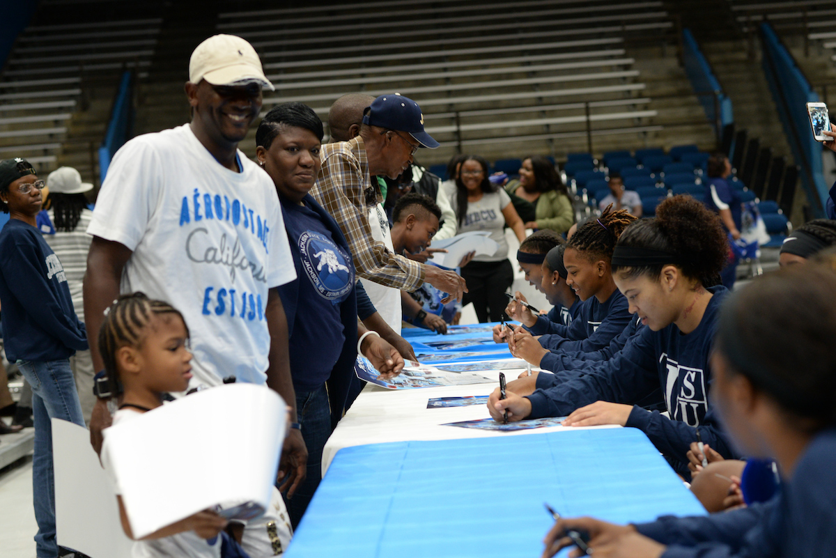 JSU's women's basketball members greet supporters during Basketball Madness, signing posters. (Photo by Darek Ashley/JSU)