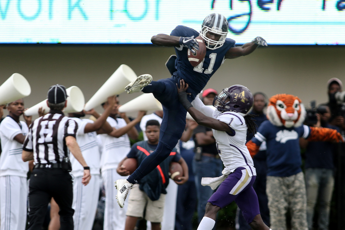 Senior wide receiver Jevon Floyd soars above Alcorn. (Photo by Charles A. Smith/JSU)