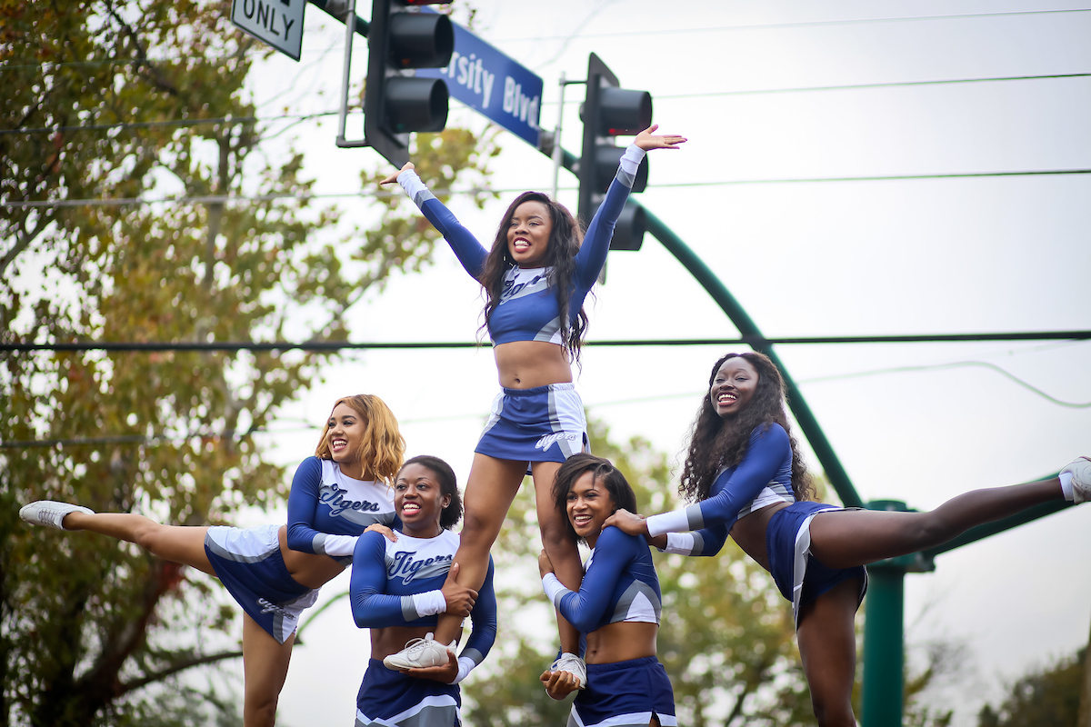 JSU Cheerleaders pull out all the stops, including signal lights above.