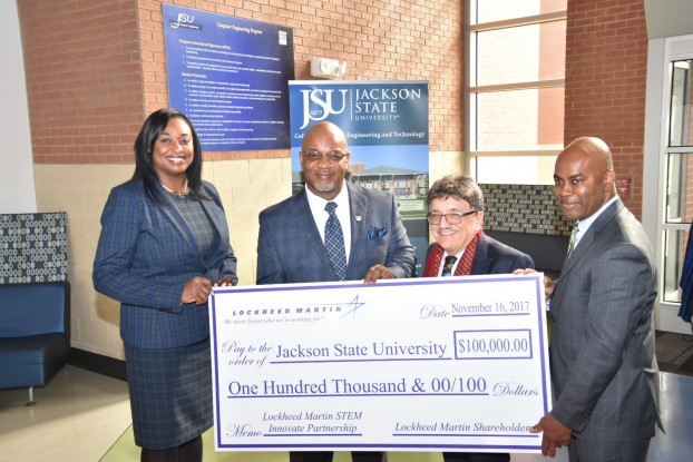 JSU President William B. Bynum Jr. displays his appreciation to Lockheed Martin for its donation to the College of Science, Engineering and Technology (CSET). He's joined by Lockheed director Karmyn Norwood, a JSU alum; Dr. Richard A. Alo, dean of CSET; and Derrick McGowan, diversity outreach manager for Lockheed. (Photo by Kevin Bradley/Special to JSU)