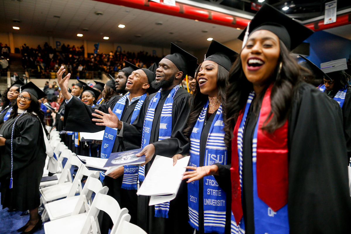"Ecstatic graduates demonstrate their affection for ""Thee I Love."" (Photo by Charles A. Smith/JSU)"