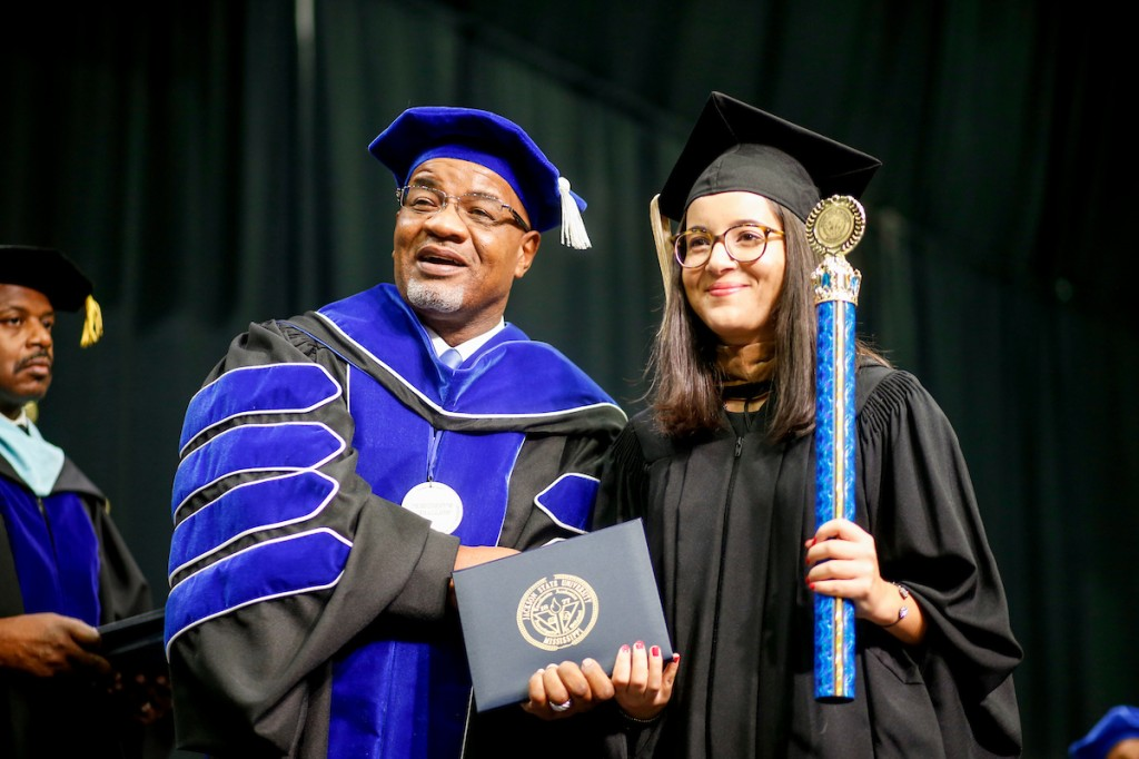 JSU President William B. Bynum Jr. congratulates JSU photography intern Anissa Hidouk. (Photo by Charles A. Smith/JSU)
