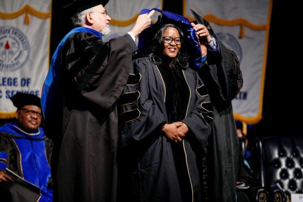 Now a doctor, a graduate in the School of Public Health earns her ultimate academic achievement. (Photo by Charles A. Smith/JSU)