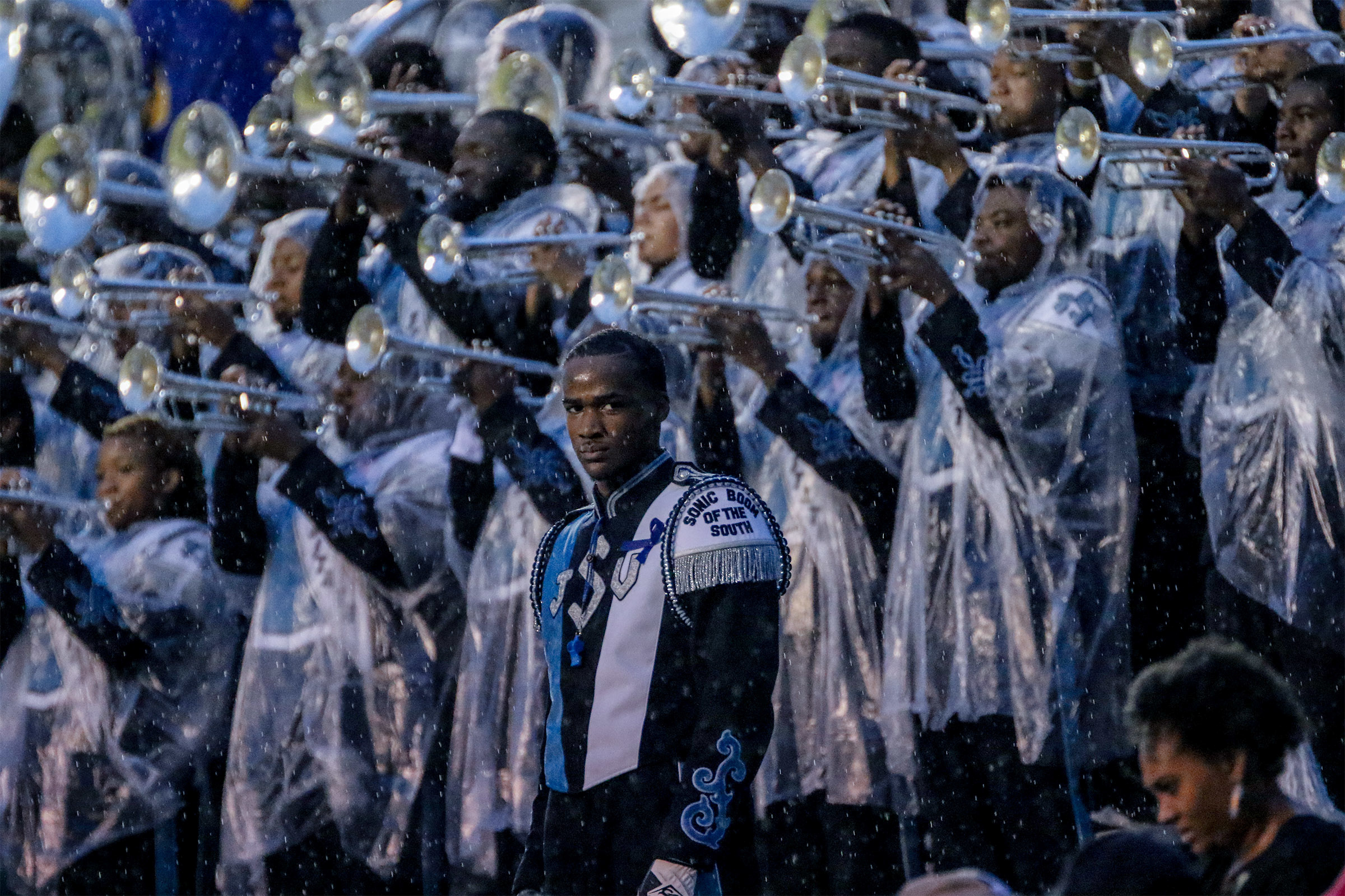 Social media associate Kentrice Rush captured lead drum major Abraham Duffie as he and members of the Sonic Boom of the South stand resolute in the rain.