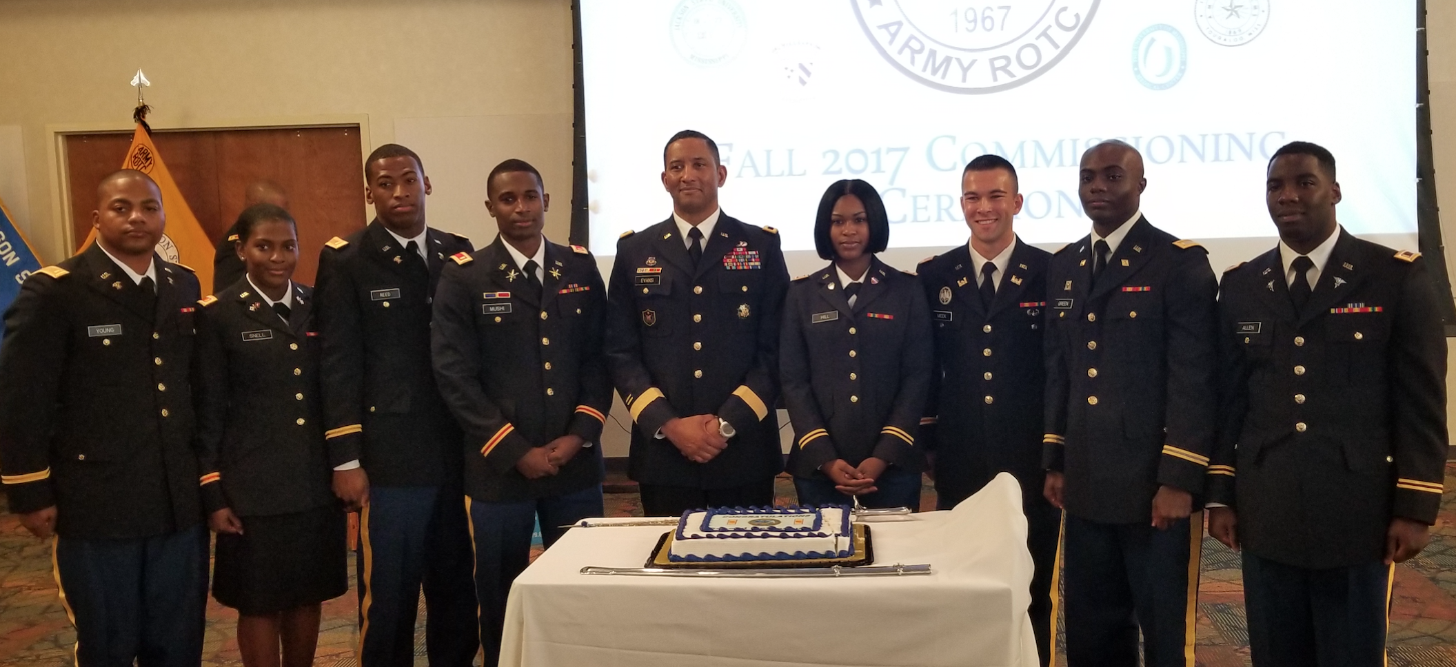 Major Gen. Jason T. Evans, center, was the keynote speaker for the commissioning and bar ceremony. He joins the newly his new fellow officers.