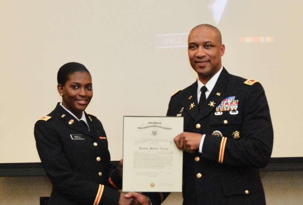 Brookins presents an official declaration to 2nd Lt. Eva N. Snell from the U.S. Army.