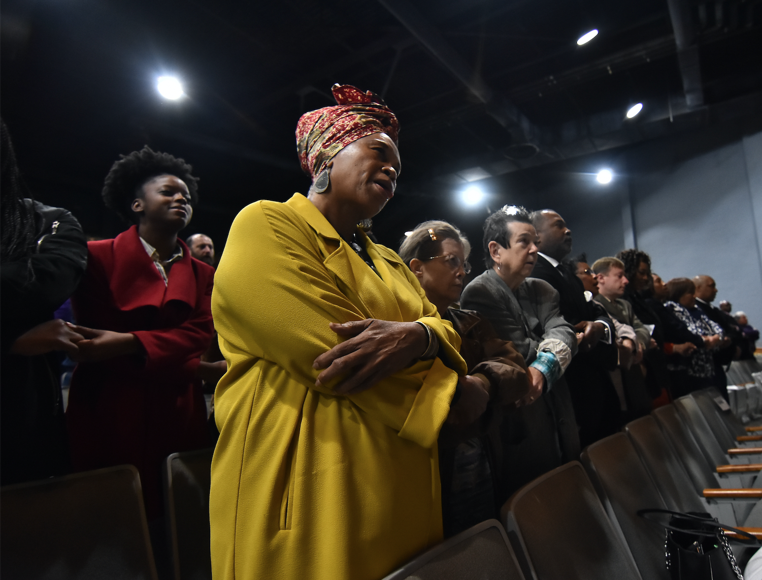 Attendees join hands and sing the civil rights anthem 'We Shall Overcome' in a show of solidarity with the movement that took place nearly 60 years ago. (Photo by William Kelly, III/JSU)