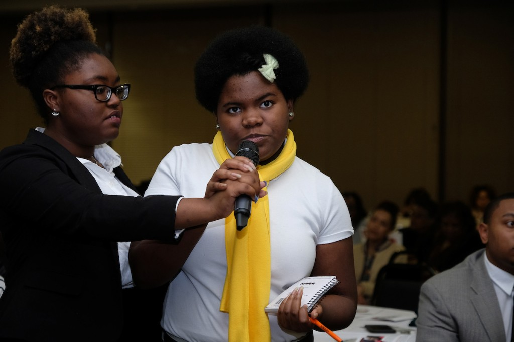 A young audience member engages the panel in a Q&A about the future of HBCUs. (Photo by Charles A. Smith/JSU)