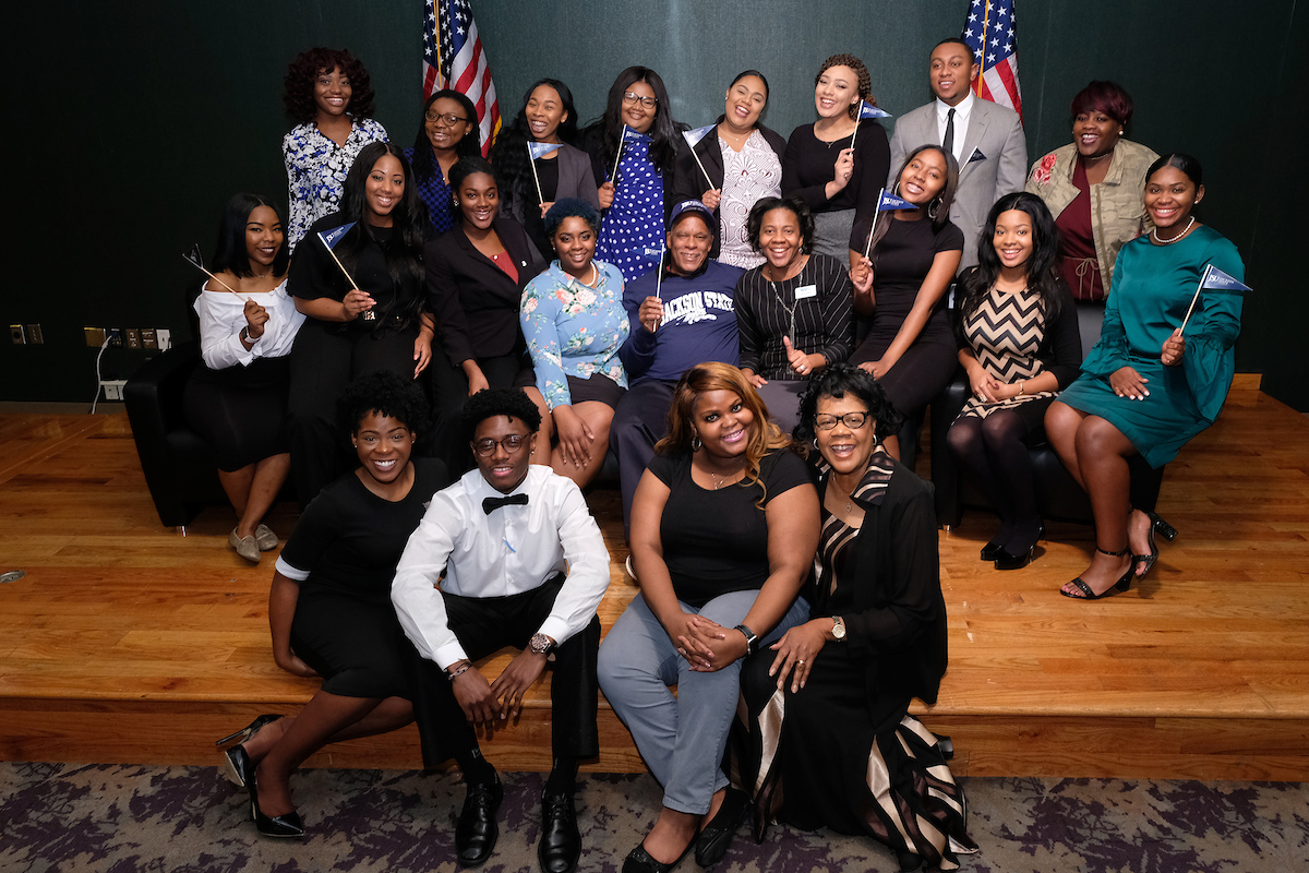 """Jackson State University students, faculty and alum assemble with award-winning documentary filmmaker Nelson after screening """"Tell Them We Are Rising: The Story of Black Colleges and Universities."""" (Photo by Charles A. Smith/JSU)"""