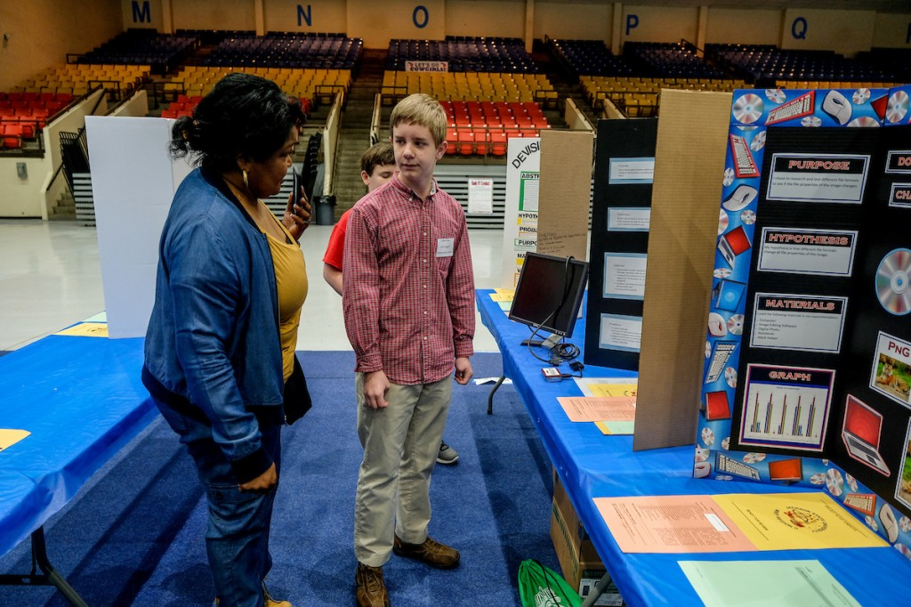 The education venue provides an opportunity for students to talk to judges about the purpose of their concepts and prototypes and get feedback on furthering the project. Students also answer questions about techniques, processes and explain how their ideas will benefit society. (Photo by Charles A. Smith/JSU)