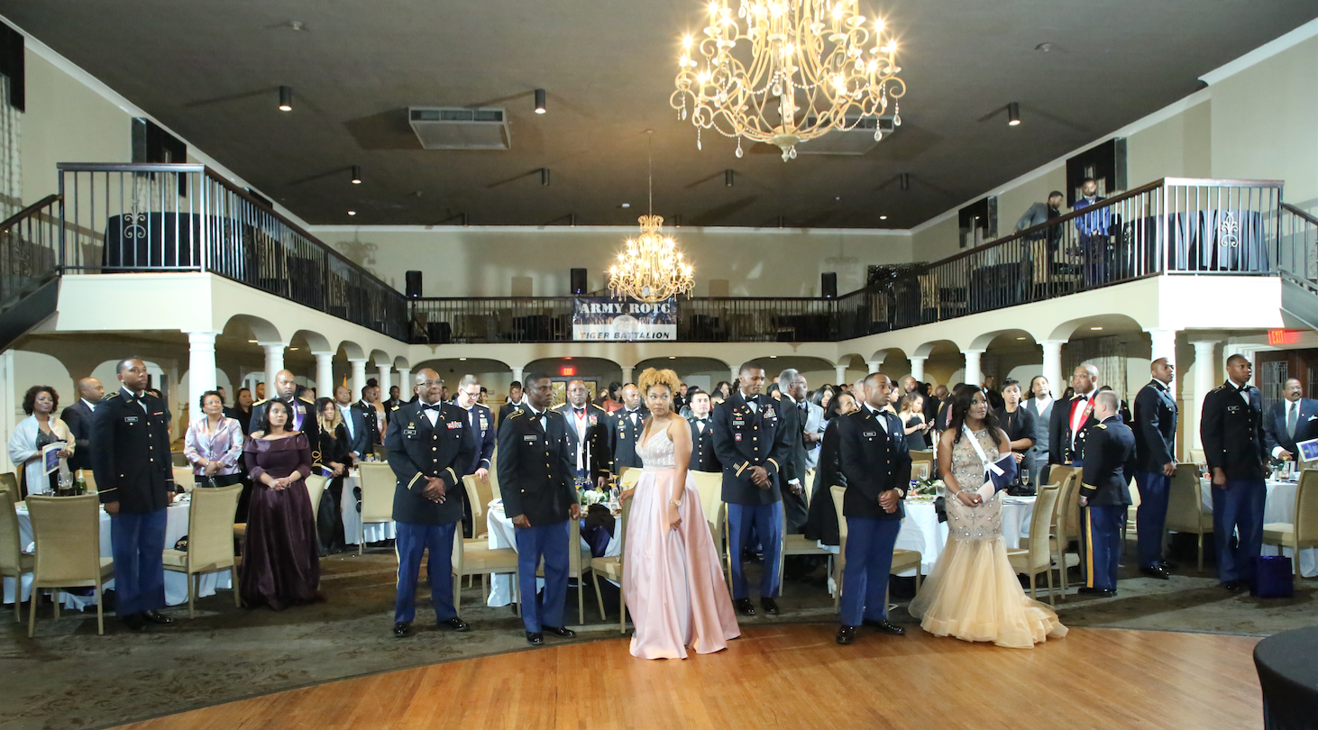 The audience stands at attention during the posting of colors, national anthem and invocation for JSU Army ROTC's 49th Annual Spring Gala. The event was help in the Old Capitol Inn in downtown Jackson.