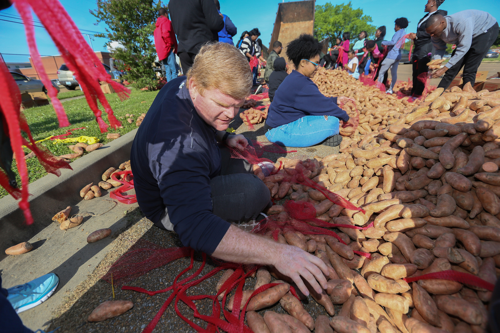 Dozens of volunteers meticulously sack the sweet potatoes that have become a hot commodity with the community during JSU's Crop Drop. (Photo by Charles A. Smith/JSU)