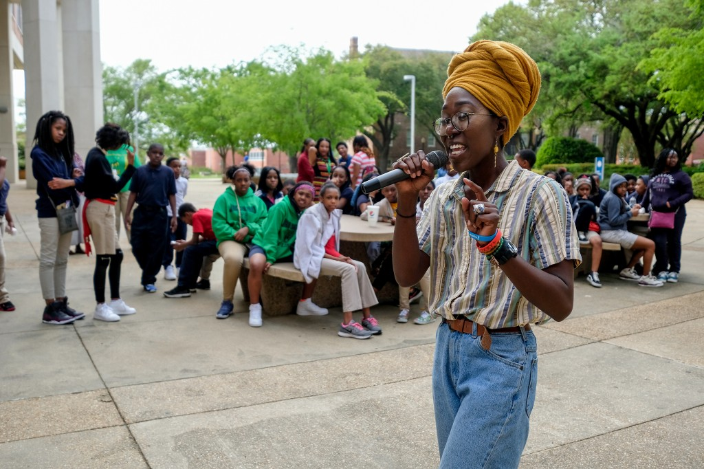 Charity Hicks, who uses the rap pseudoynm Vitamin Cea, shares some of her catchy rhymes with the Blackburn students. (Photo by Charles A. Smith/JSU)