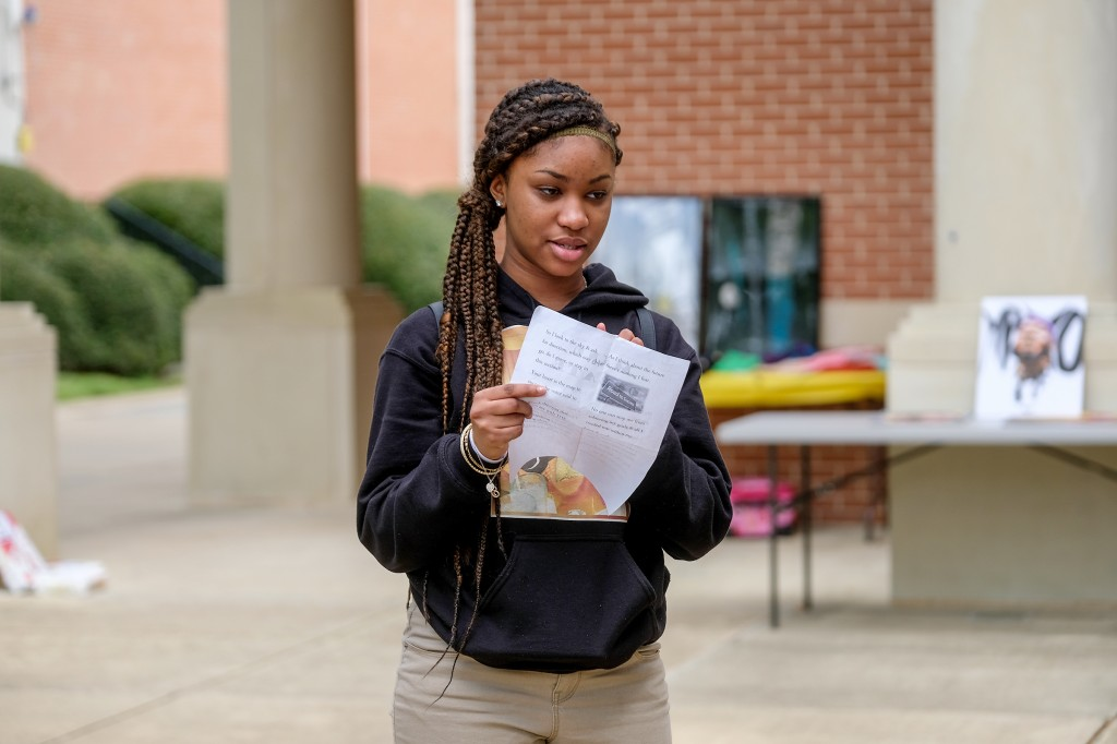 "Blackburn student Toni Brassfield recites her poem ""Mind Debate"" that explores the angst that teens face from peer pressure and doing what's right. (Photo by Charles A. Smith/JSU)"