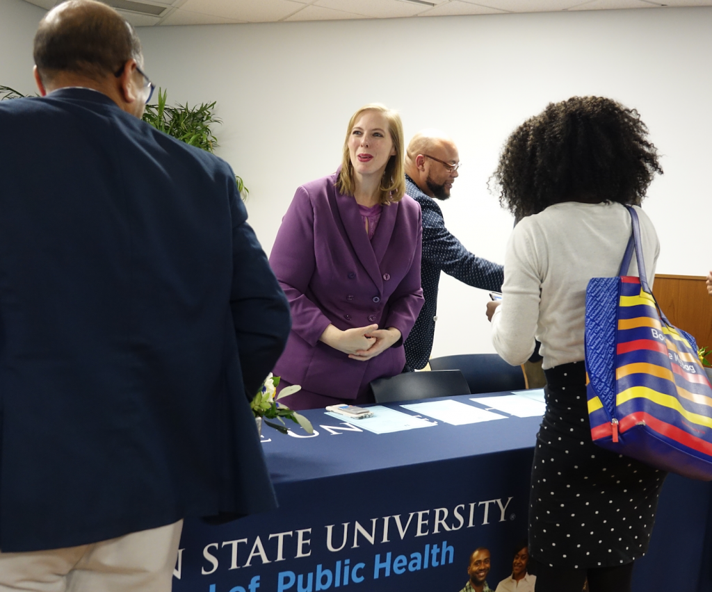JSU alum Dr. Amy Radican-Wald, a senior policy analyst for the Center for Mississippi Health Policy, engages with attendees after a forum. Earlier, Radican-Wald shared a number of ways to motivate and educate people about the significant roles of those working in the public health profession.