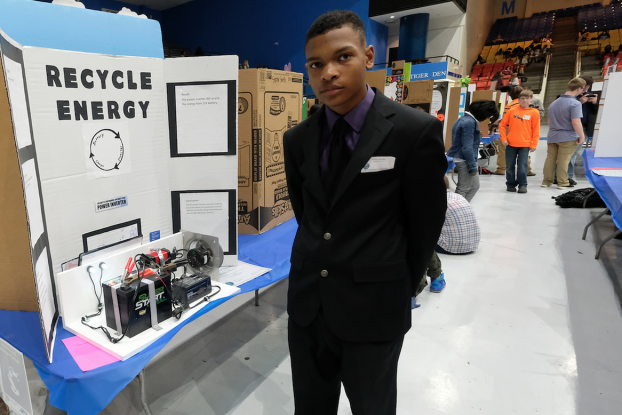 A student-competitor proves that a power inverter can recycle energy from a 12-volt battery. (Photo by Charles A. Smith/JSU)