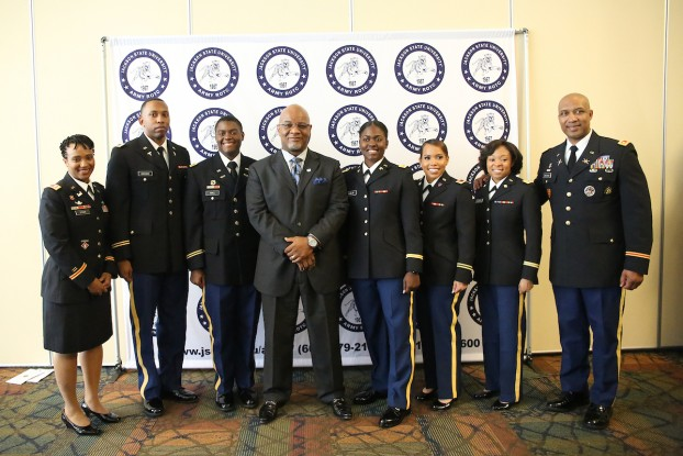 JSU President William B. Bynum Jr. and Lt. Col. Dexter Brookins congratulate five new second lieutenants and an alum earning the rank of lieutenant colonel during a commissioning ceremony. The honorees are Lt. Col. Natalie Bynum, left, and 2nd Lieutenants Gabriel E. Brown, Louis J. Hall, Ebony C. Dunlap, Andrea N. Thomas and Rolundra O. Rhodes. (Photo by Aron Smith/JSU)