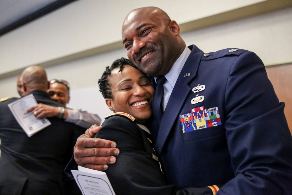 Newly promoted U.S. Army Lt. Col. Natalie Bynum is congratulated by U.S. Air Force Lt. Col. Chris Wright. Bynum is a 2001 graduate who was commissioned by JSU ROTC. While at JSU, she was a J-Sette and a member of the Delta Pi chapter of Delta Sigma Theta, Inc. This summer, she will become the chair and professor of military science at North Carolina AT&T. (Photo by Aron Smith/JSU)