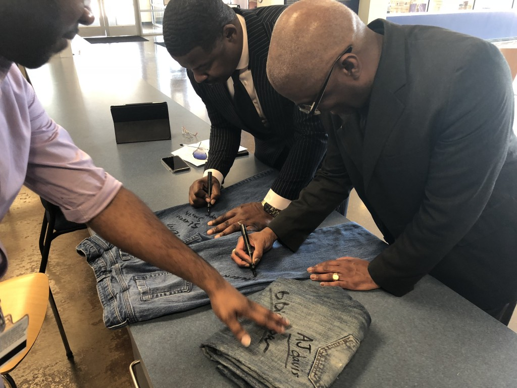 During the recent event for Denim Day, which highlights sexual assault awareness, Horton encouraged students, faculty and staff to sign jeans to show their support of the campaign. Dr. Steven Smith, left, associate dean of JSU's Enrollment Management and director of Admissions and Recruitment, pens his name to the garment. Warren Johnson, associate, vice president and dean of Enrollment Management, joins him in a show of solidarity. (Photo by L.A. Warren/JSU)