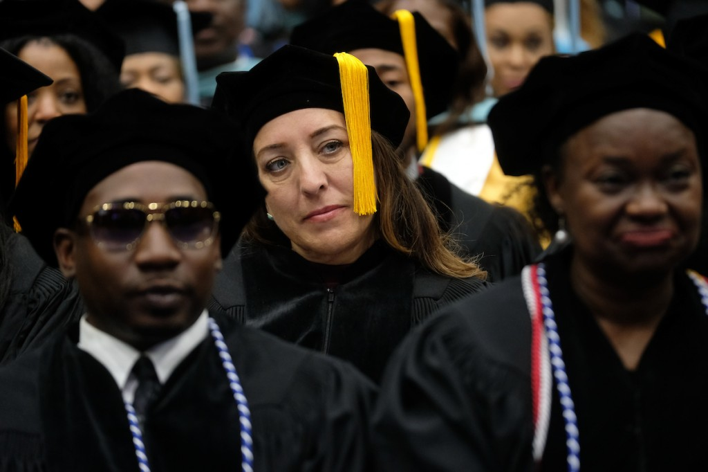Graduates listen intently to the commencement speech delivered by Moore. (Photo by Charles A. Smith/JSU)