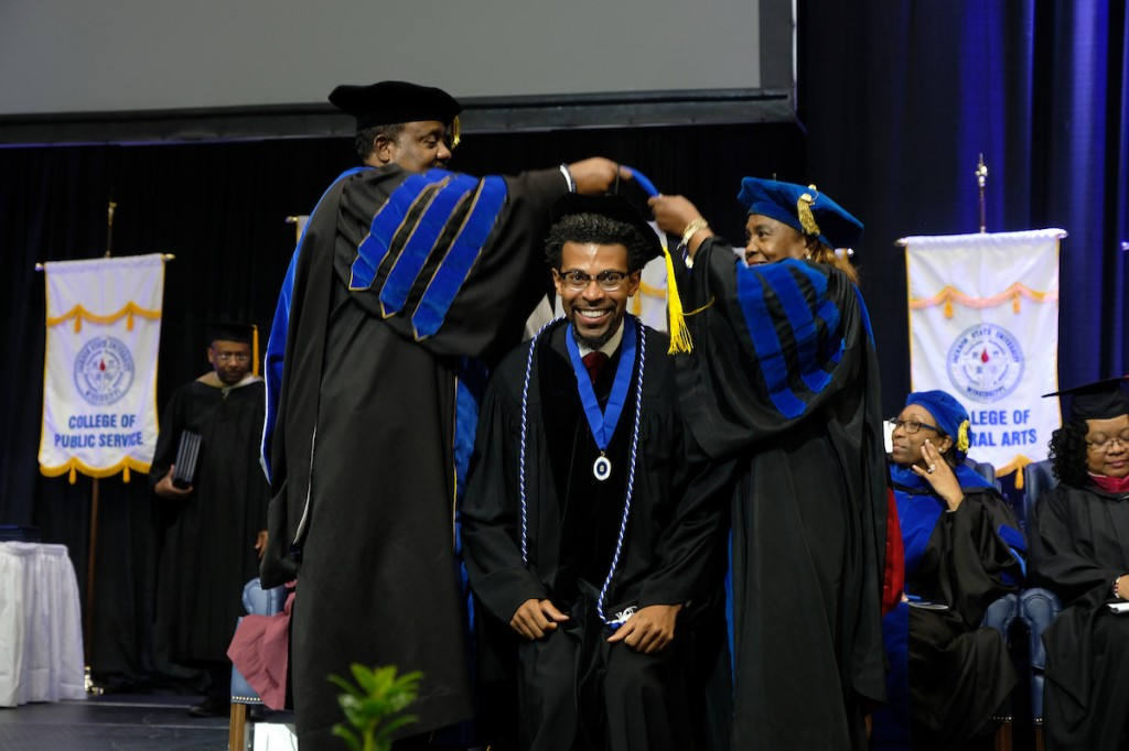 """After receiving his degree, Dr. Theon Johnson III said, """"I am deeply grateful to have the privilege to do my graduate study at Jackson State University. I believe in the mission, vision and values of the university."""" He titled his dissertation """"Leading With Spirit: Study on the Impact of Spirituality in the Leadership Practices of United Methodist Related Historically Black College and University Presidents."""" (Photo by Charles A. Smith/JSU)"""