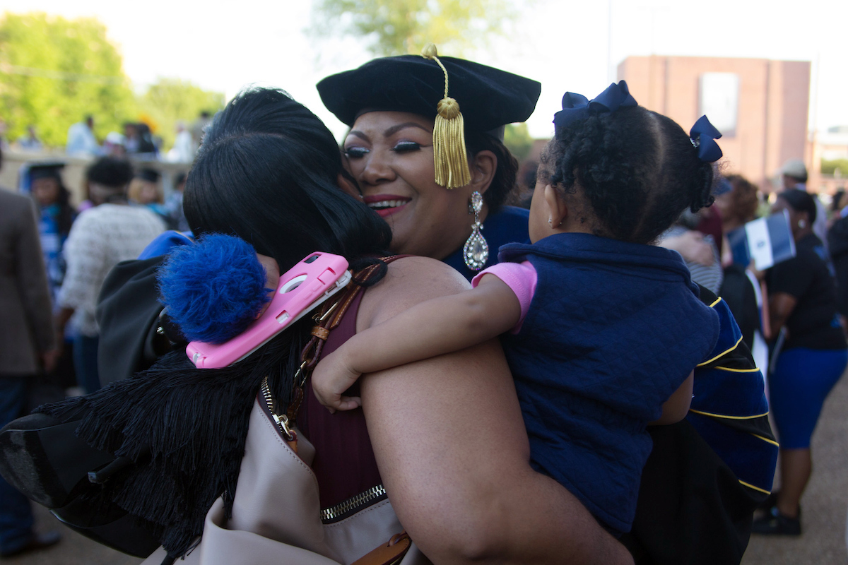 After the ceremony, family members join in the celebration outside the Lee E. Williams Athletics and Assembly Center. (Photo by Mary Vaughn/JSU)