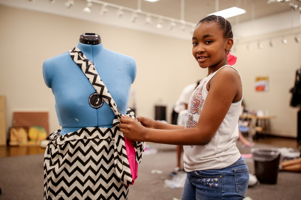 Destiny Jackson, a rising sixty grader, shows off the purse and skirt that she crafted while participating in the JSU sewing summer camp. The 11-year-old hopes to be a fashion designer crafting garments for women and young girls. (Photo by Charles A. Smith/JSU)