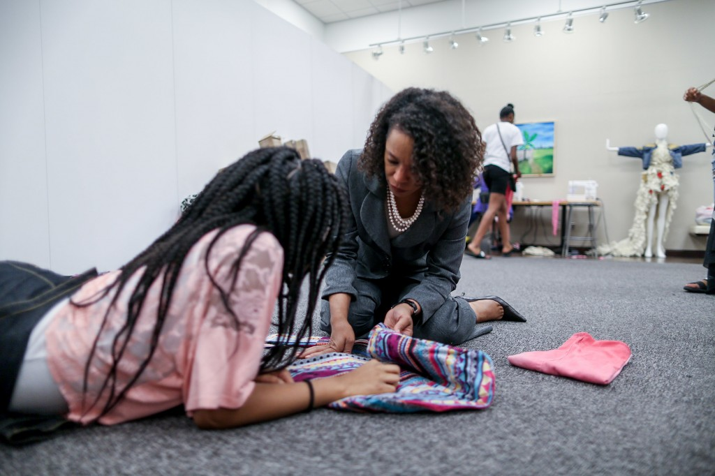 Shonda McCarthy, director of JSU art galleries, has a hands on approach while helping students in her JSU summer sewing camp. (Photo by Charles A. Smith/JSU)