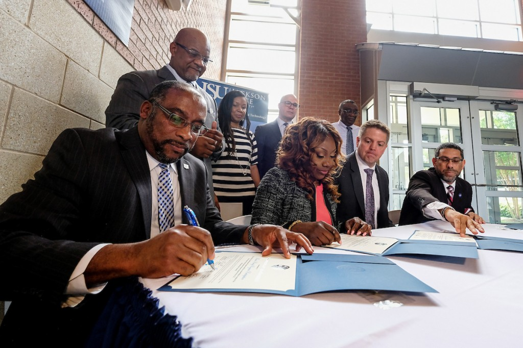 Dr. Joseph A. Whittaker signs a deal that eventually will position JSU as a prime federal contractor. The urban institution will be part of a protégé program that provides training from its mentor, Enterprise Services LLC. (Photo by Charles A. Smith/JSU)