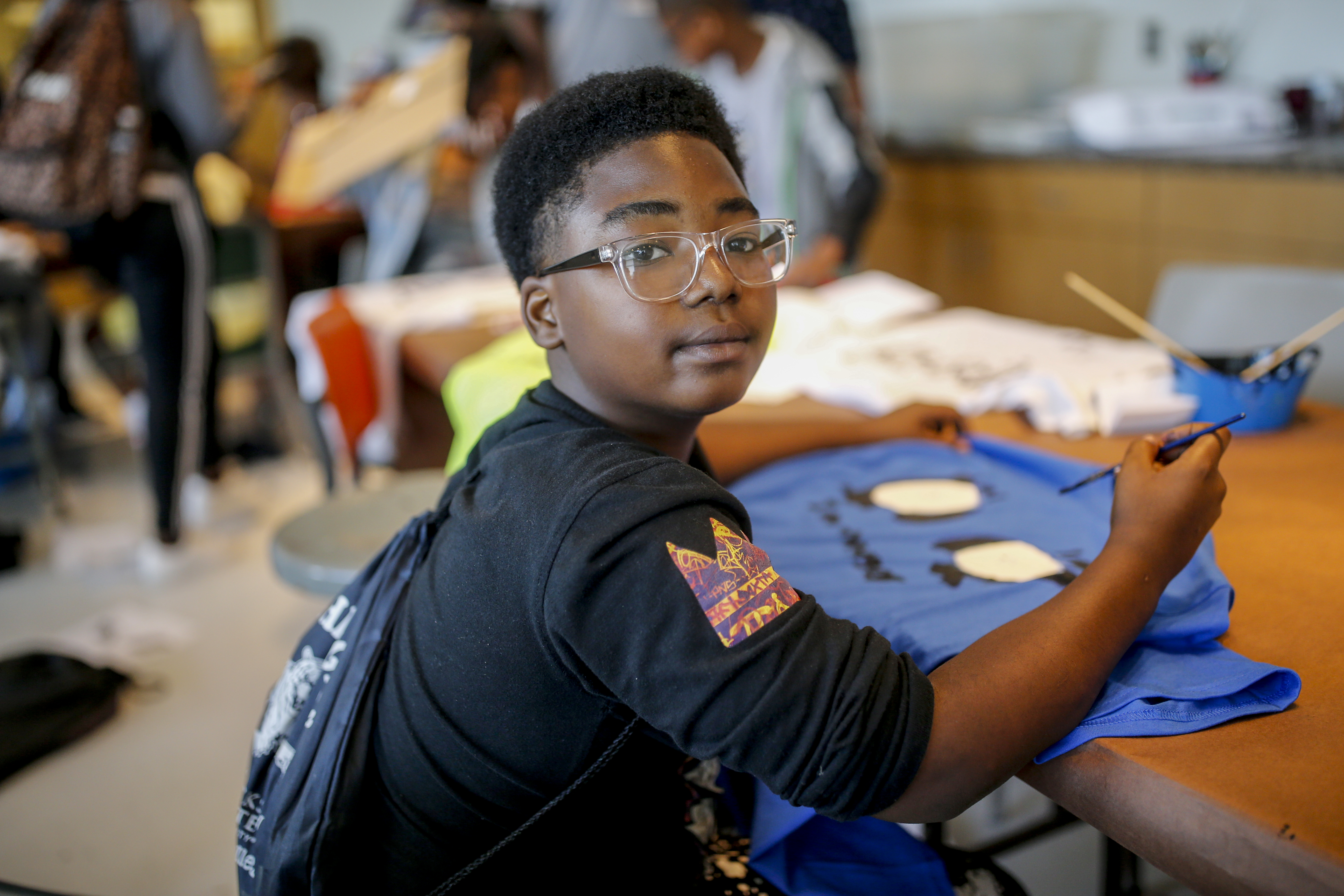 "Sixth-grader Charles Dishmon, who enjoys learning and having fun with his friends, says that he feels good about his ""Thee I Love"" tiger t-shirt. (Photo by Charles A. Smith/JSU)"