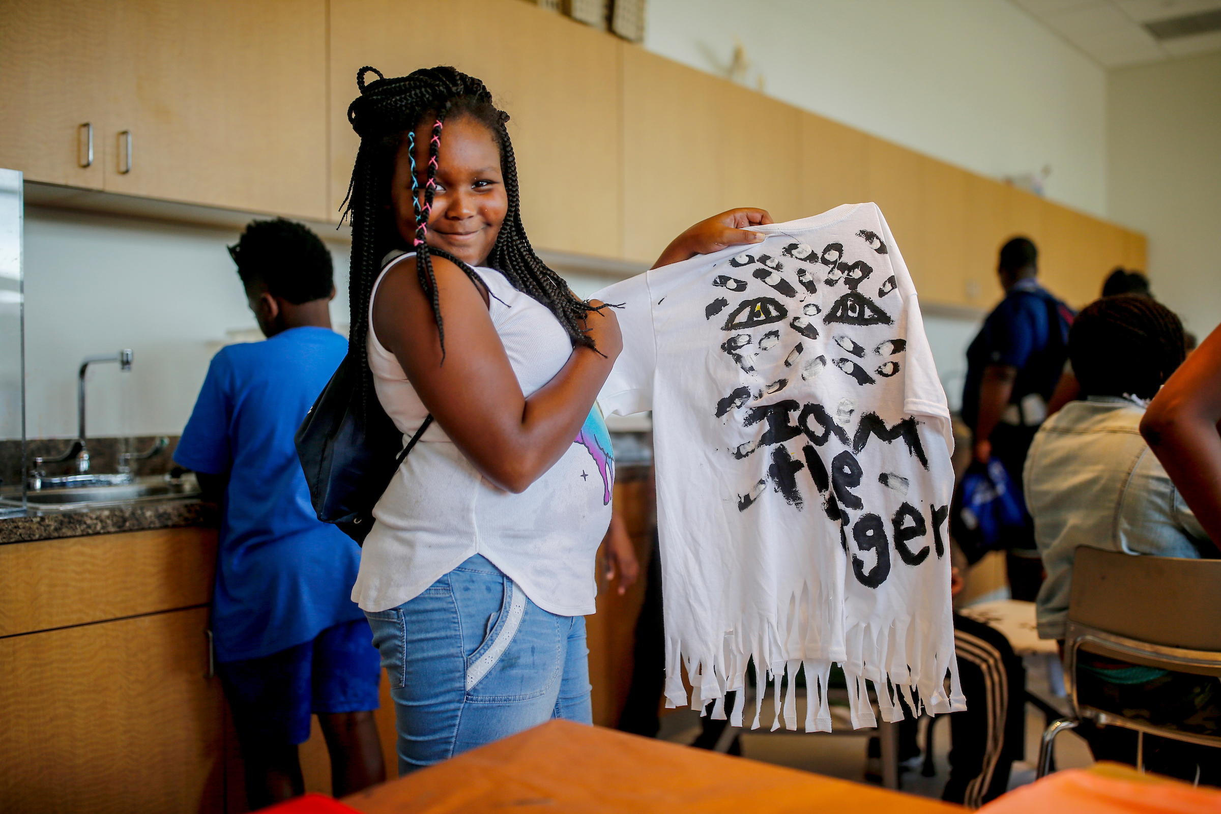 "A happy summer camper shows off her ""Thee I Love"" tiger t-shirt crafted at JSU's Summer Art Institute which helps to provide art instruction to over 250 students from in and around the metro area. (Photo by Charles A. Smith/JSU)"
