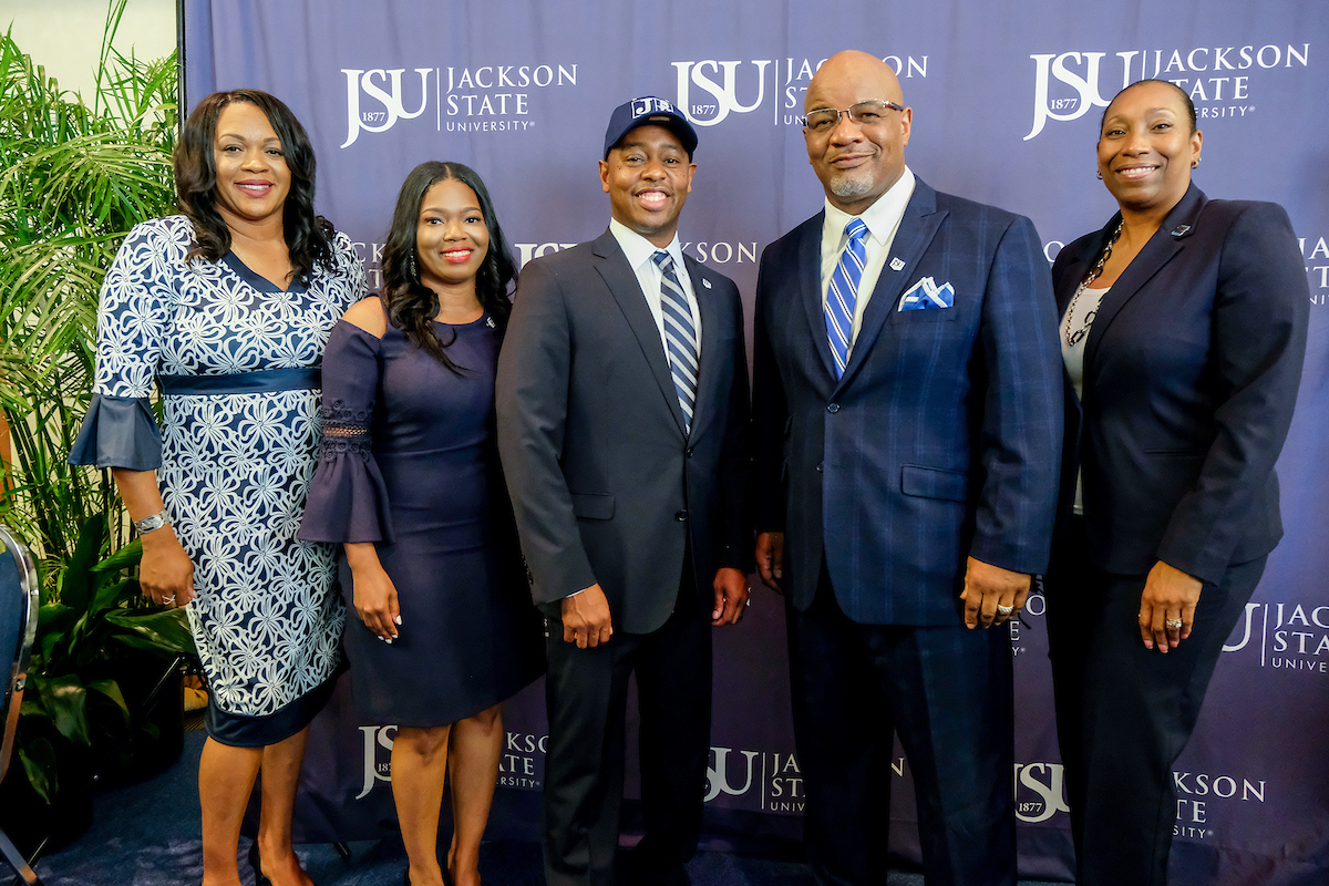 Robinson is joined by Genese Lavalais, left, JSU's associate director of athletics for academics; his wife, Danielle; JSU President William B. Bynum Jr., and Dr. Debra Mays-Jackson, JSU's vice president and chief of staff. (Photo by Charles A. Smith/JSU)