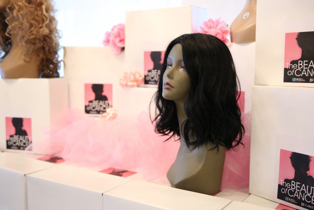 """A recent event by WJSU has provided nearly 80 wigs to the American Cancer Society to help women who are losing or have lost hair due to cancer treatment. Station manager Gina Carter-Simmers, a breast cancer survivor, organized the Beauty of Cancer Wig Project. She said, """"It's funny that of all I've been through – fighting breast cancer twice, eight months of chemo and currently going through immunotherapy – what I actually cried about was losing my hair twice. Sounds funny. I knew it would fall out twice, and I cried both times."""" (Photo by Spencer L. McClenty/JSU)"""
