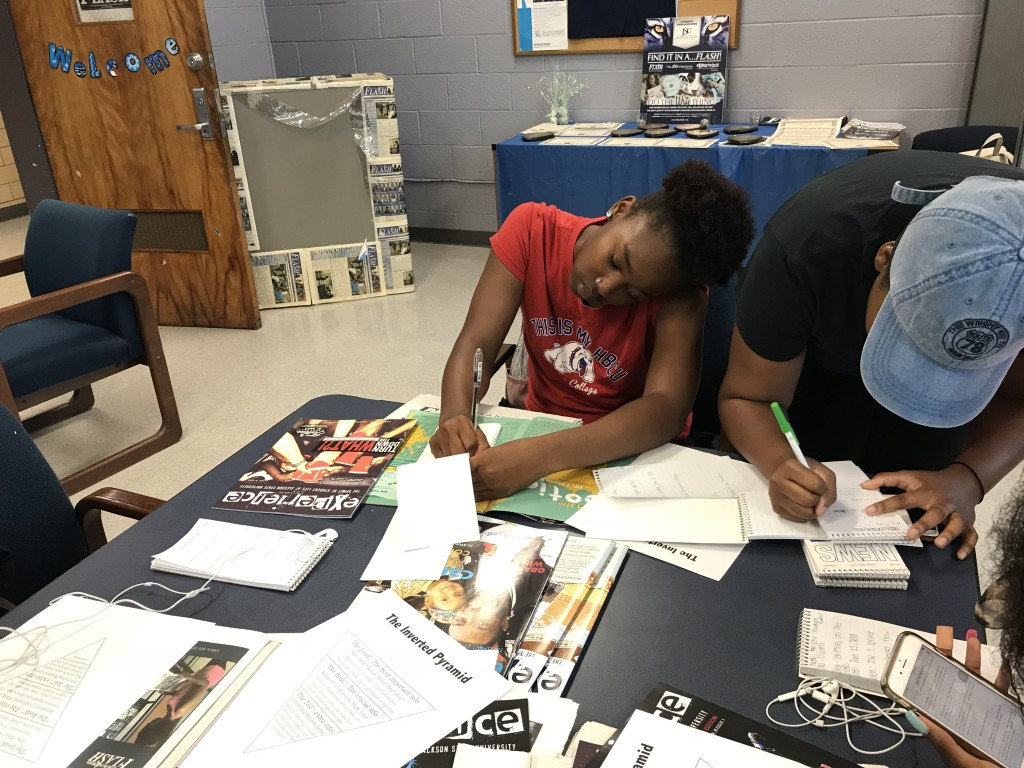 Paisley Williams works on a media assignment during a hands-on exercise with The Blue & White Flash. (Photo by Kerriana Moore/Special to JSU)
