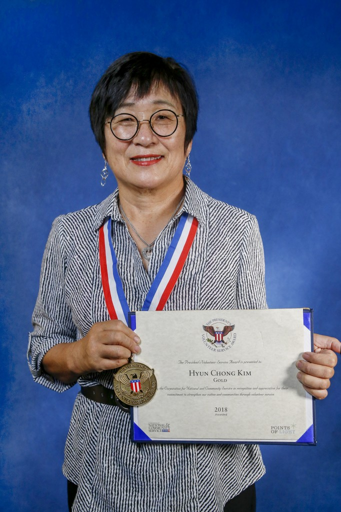 Kim poses with the medal and certificate she received from the White House for her impressive volunteer efforts. (Photo by Charles A. Smith/JSU)