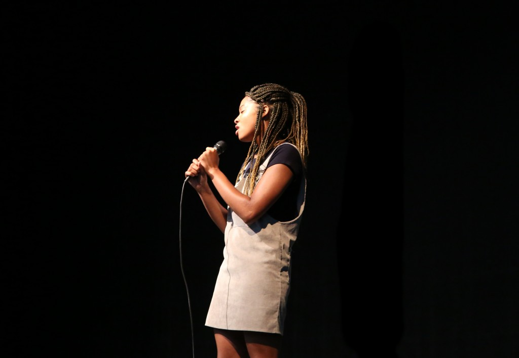 "Jonet Washington, a senior at JSU and member of OutSpoken, sang an acapella and goose-bump inducing version of Mariah Carey's song ""Hero."" (Photo by Kentrice S. Rush/JSU)"