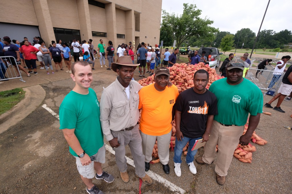 The team responsible for providing and transporting the produce gathers in solidarity. (Photo by Charles A. Smith/JSU)
