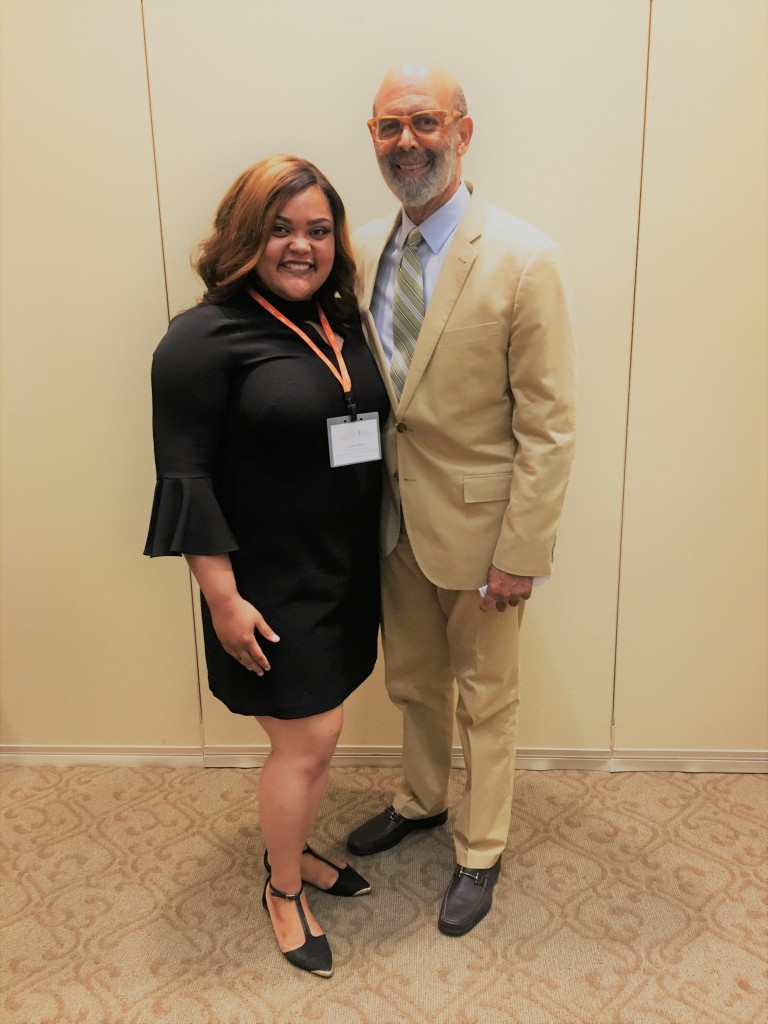 Jasmine Gibson, senior education major at JSU, snaps it up with Michael Lomax, CEO of the United Negro College Fund. (Photo special to JSU)