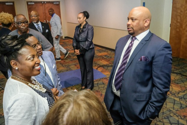 Rankins receives a cordial greeting from JSU constituents after his address Wednesday in the Student Center Ballroom. (Photo by Charles A. Smith/JSU)