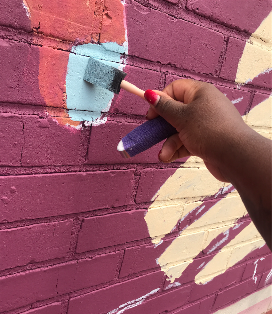 An unfortunate mishap resulted in Talameika breaking her finger. However, the artist persisted and together, she and her husband, were able to still complete the mural in time for the Aug. 17 unveiling ceremony. (Photo special to JSU.)