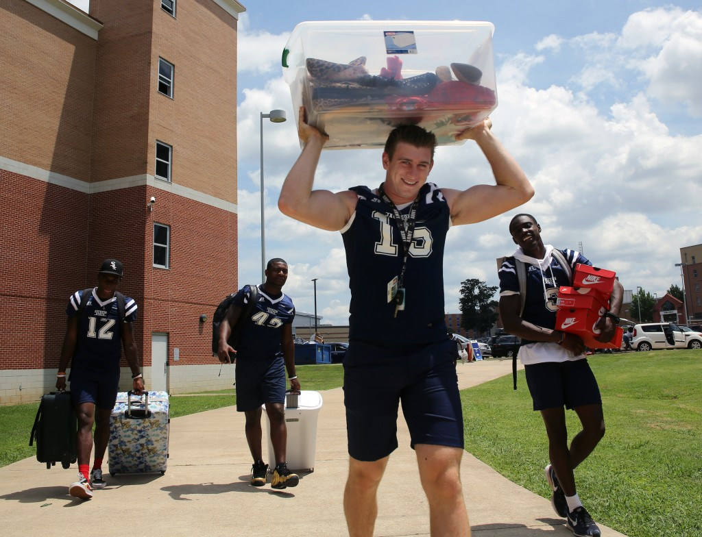 Jack Strouse (center) from Orange County, California was won over by the JSU spirit. Strouse, a freshmen quarterback, says he is looking forward to the football season. (Photo by Charles A. Smith/JSU)