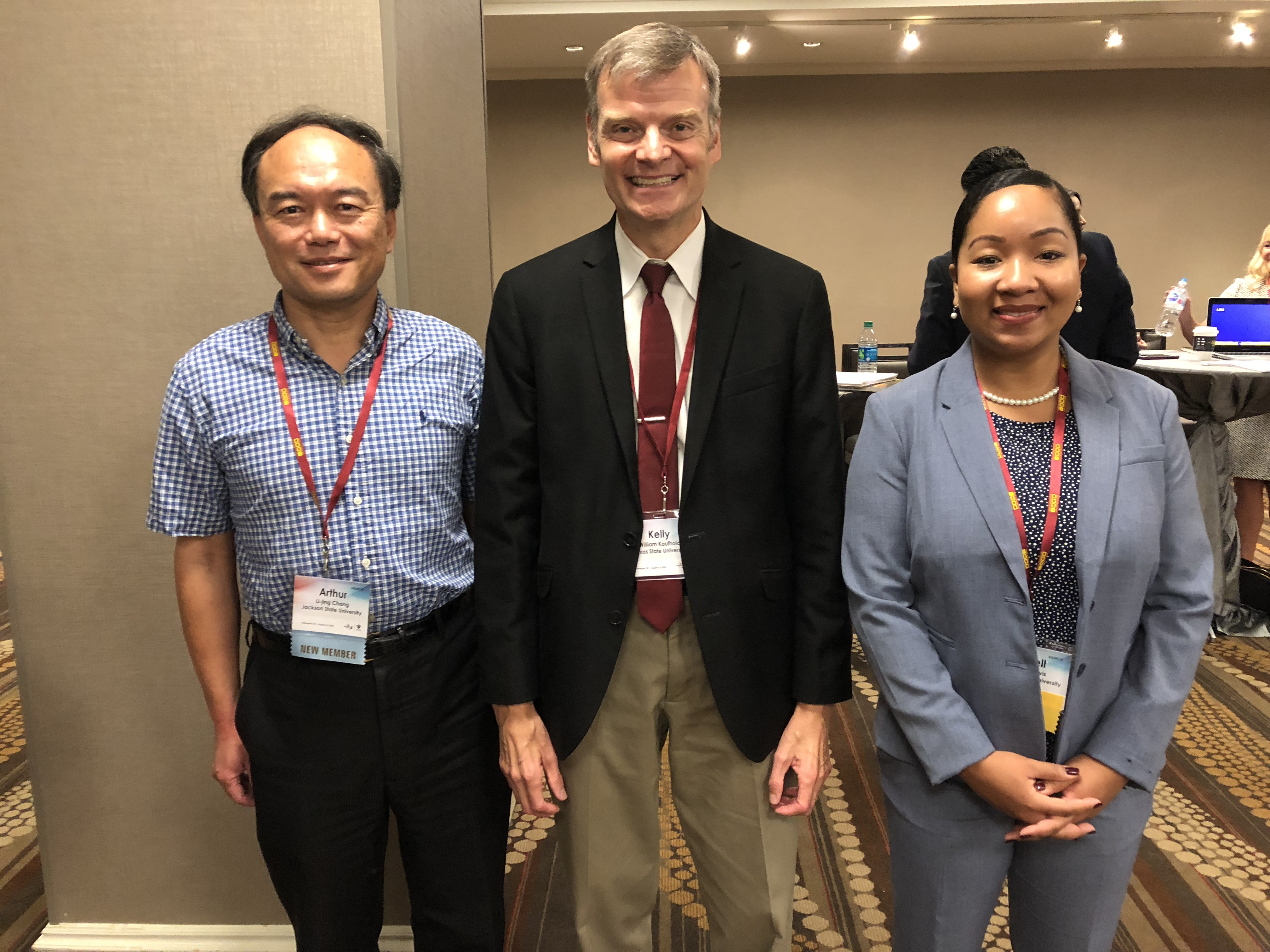Jewell Davis, JSU alum, who was selected to present her graduate research at the Association for Education in Journalism and Mass Communications Conference is pictured with Dr. Li-jing Arthur Chang(l), assistant professor at JSU; and Dr. Kelly Kaufhold of Texas State University who served as session moderator. (Photo special to JSU)