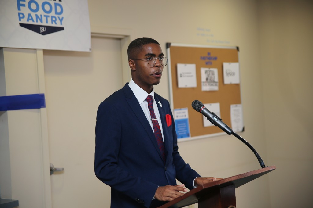 Khaylan Foy, the university's Mr. Senior (2018-2019) introduces Dr. William B. Bynum Jr., to share remarks with the audience at the ribbon-cutting for the Tiger Food Pantry. (Aron Smith/University Communications)